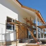 Construction or Repair of the Rural House with Skylights, Eaves, Windows, Fixing Facade, Insulation, Plastering and Painting House Facade Wall. Install Plastic Siding Soffits and Eaves Exterior.